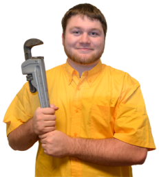 Plumber in Cedar Hill poses with a wrench